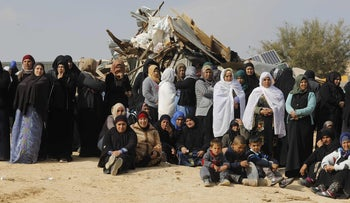 Bedouin women react to the destruction of houses on January 18, 2017 in al-Hiran