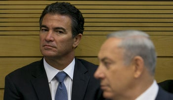 Mossad Director Yossi Cohen observes Prime Minister Benjamin Netanyahu during a Knesset committee meeting in December, 2015.
