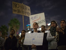 People protest the appointment of alt-right media mogul Steve Bannon as chief strategist by President-elect Donald Trump, Los Angeles, California, U.S., November 15, 2015.