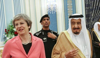 Theresa May, U.K. prime minister, left, stands next to King Salman bin Abdulaziz, Saudi Arabia's king, center, during their meeting at Al-Yamamah Palace in Riyadh, Saudi Arabia, on Wednesday, April 5, 2017