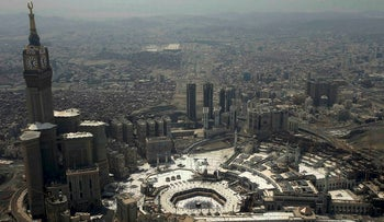 General view from a plane window shows muslims as they pray at the Grand mosque during the annual Haj pilgrimage, in Mecca, Saudi Arabia September 2, 2017.