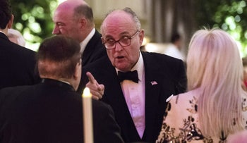 Rudy Giuliani speaks with Sheldon Adelson and wife Miriam at the 'Chairman's Global Dinner' in Washington, D.C., U.S., January. 17, 2017.