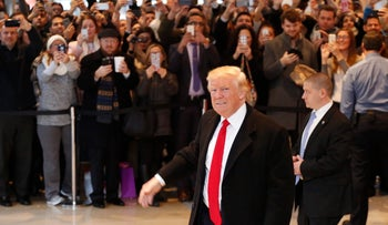U.S. President-elect Donald Trump walks past a crowd as he leaves the New York Times building following a meeting, New York, U.S., November 22, 2016.
