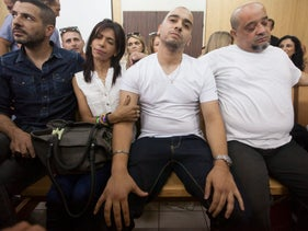Elor Azaria in court with his parents, July 30, 2017.