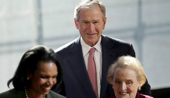 Former U.S. President George W. Bush greets former U.S. Secretary of State  Condoleezza Rice, left, and Madeleine Albright, right, after they participated in a panel discussion at a forum sponsored by the George W. Bush Institute in New York, Thursday, Oct. 19, 2017.