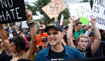 Demonstrators gather at the site of a planned speech by white nationalist Richard Spencer, who popularized the term 'alt-right', at the University of Florida campus on October 19, 2017 in Gainesville, Florida.