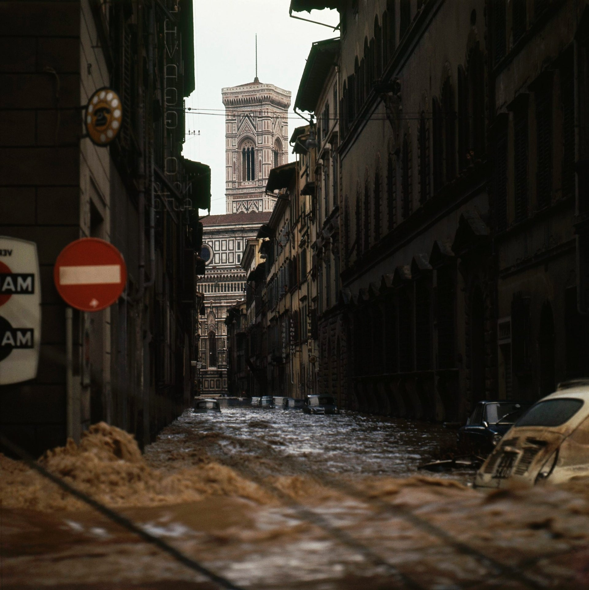 Via Ricasoli in Florence, Italy on November 4, 1966 after it has been completely flooded by the waters of the Arno. In background the famed bell tower of Giotto.