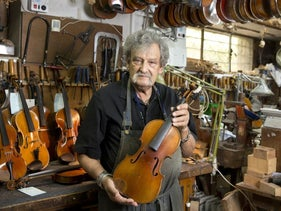 Amnon Weinstein, the driving force behind Violins of Hope, with the violin that belonged to Fanny Hecht.