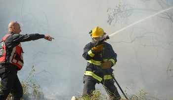 Firefighters battle the flames in the northern town of Zichron Yaakov on Wednesday, November 23, 2016.