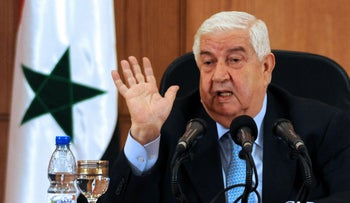Syrian Foreign Minister Walid Moallem in Damascus, August 27, 2013