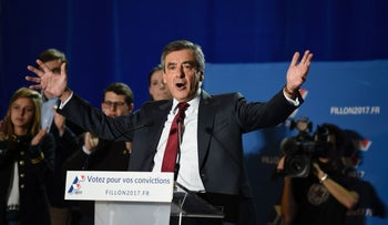 Candidate for the right-wing Les Republicains (LR) party primaries ahead of the 2017 presidential election and former French prime minister Francois Fillon delivers a speech during a meeting on November 22, 2016 in Chassieu, southwestern France.