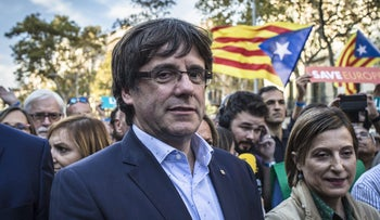 Catalan leader Carles Puigdemont participates in a demonstration against the Spanish government and the imprisonment of separatist leaders, Barcelona, Spain, October 21, 2017.
