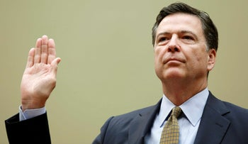 "FBI Director James Comey is sworn in before testifying at a House Oversight and Government Reform Committee on the ""Oversight of the State Department"" in Washington U.S. on July 7, 2016."
