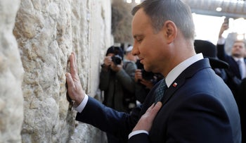 Polish President Andrzej Duda touching the Western Wall during a four-day visit to Israel, January 17, 2017.