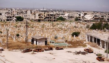 A view of damaged buildings and graves in the Baba Amr neighborhood of Homs, Syria July 28, 2017.