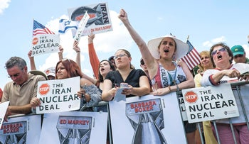 Attendees hold signs and cheer during a Tea Party Patriots rally against the Iran nuclear deal on Capitol Hill in Washington, D.C., U.S., on Wednesday, Sept. 9, 2015