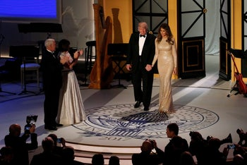 U.S. President-elect Donald Trump and his wife Melania take the stage with Vice President-elect Mike Pence and his wife Karen at a pre-inauguration dinner at Union Station in Washington, U.S. January 19, 2017.