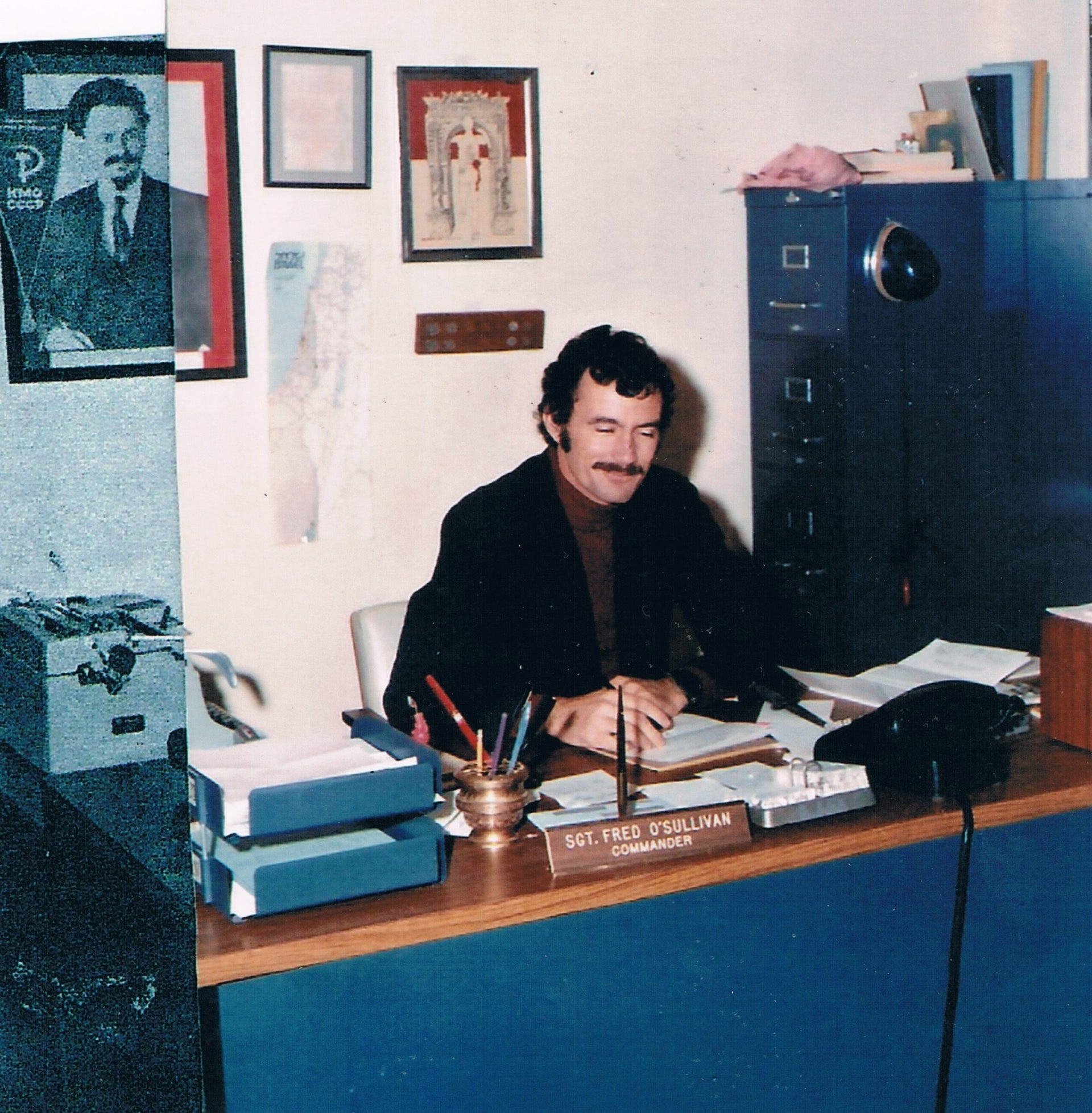 Efraim O'Sullivan at his desk as intelligence chief of the New Orleans Police Department in 1973, the year he immigrated to Israel with his family.