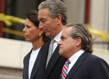 Charles Kushner, center, walks to the U.S. District Courthouse with his lawyer Benjamin Brafman, right, and his wife, Seryl, in Newark, N.J., Wednesday, Aug. 18, 2004. .