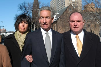 Charles B. Kushner is flanked by his wife, Seryl Beth, left,and his attorney Alfred DeCotiis as he arrives at the  Newark Federal Court for sentencing. March 4, 2005.