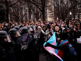 Protesters confront riot police on K Street Northwest outside the offices of The Washington Post as they react to the swearing in of U.S. President Donald Trump in Washington, U.S., January 20, 2017.