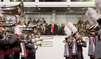resident Donald Trump watches as a marching band passes the reviewing stand during his inaugural parade on Pennsylvania Ave. outside the White House in Washington, Friday, Jan. 20, 2017.