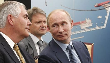 Russian President Vladimir Putin, right, and Exxon Mobil Corp. CEO Rex Tillerson, left, attend a signing ceremony of an agreement between state-controlled Russian oil company Rosneft and Exxon Mobil corporation at the Black Sea port of Tuapse, southern Russia, Friday, June 15, 2012