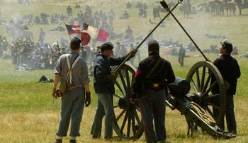Members of the Union Army artillery fire on Confederate Army units during the reenactment of the Battle of Gettsyburg, Sunday, July 7, 2002, in Gettysburg, Pa. More than 3,200 Civil War enthusiasts took part in the three-day event.