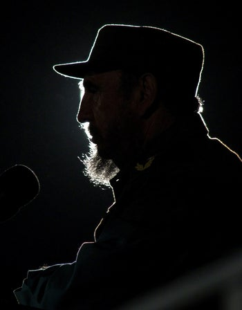 Then Cuban President Fidel Castro addresses the audience during an event with his Venezuelan counterpart Hugo Chavez on Havana's Revolution Square in this February 3, 2006 file photo.