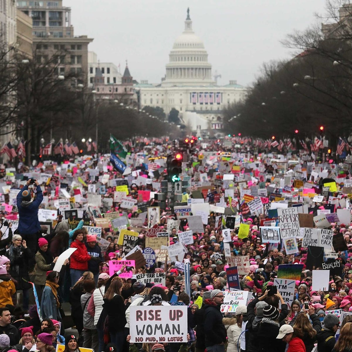 Protesters walk during the Womenױs March on Washington, with the U.S. Capitol in the background, on January 21, 2017.
