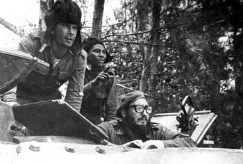 FILE - In this April 1961 file photo, Cuba's leader Fidel Castro, bottom, looks out from a tank during the Bay of Pigs invasion in Cuba.