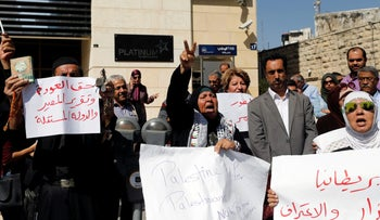 Palestinians take part in a protest calling on Britain to apologize for the Balfour Declaration, in the West Bank city of Ramallah October 18, 2017.