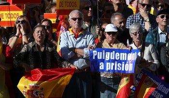 Pro-unity demonstrators with banners calling for the imprisonment of fired Catalan President Carles Puigdemont gather in Madrid, Spain, October 28, 2017.