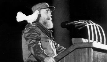 This file photo taken on January 8, 1989 shows a white dove landing on Fidel Castro's shoulder as he delivers a speech at a ceremony to commemorate the 30th Anniversary of the Cuban Revolution.