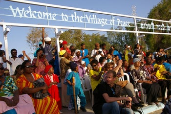 African Hebrew Israelites and guests watch a June 2012 ceremony at the community's compound, an 'urban kibbutz' known as the Village of Peace, in Dimona, southern Israel