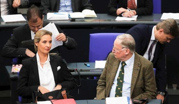 Alice Weidel, left, and Alexander Gauland, right, leaders of the Alternative for Germany, AfD, attend the first meeting of the German parliament in Berlin, Germany, Tuesday, Oct. 24, 2017