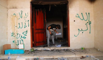 File photo: a man at the U.S. Consulate in Benghazi, Libya, after the attack, Sep 12 2012