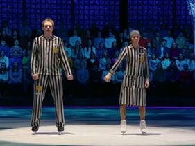 Russian Olympic champion Tatiana Navka and a partner skate on a Russian reality show dressed in a concentration camp uniform.