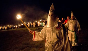 "/>In this Saturday, April 23, 2016 photo, members of the Ku Klux Klan participate in cross burnings after a ""white pride"" rally in rural Paulding County near Cedar Town, Ga. Born in the ashes of the smoldering South after the Civil War, the KKK died and was reborn before losing the fight against civil rights in the 1960s. Membership dwindled, a unified group fractured, and one-time members went to prison for a string of murderous attacks against blacks. Many assumed the group was dead, a white-robed ghost of hate and violence."