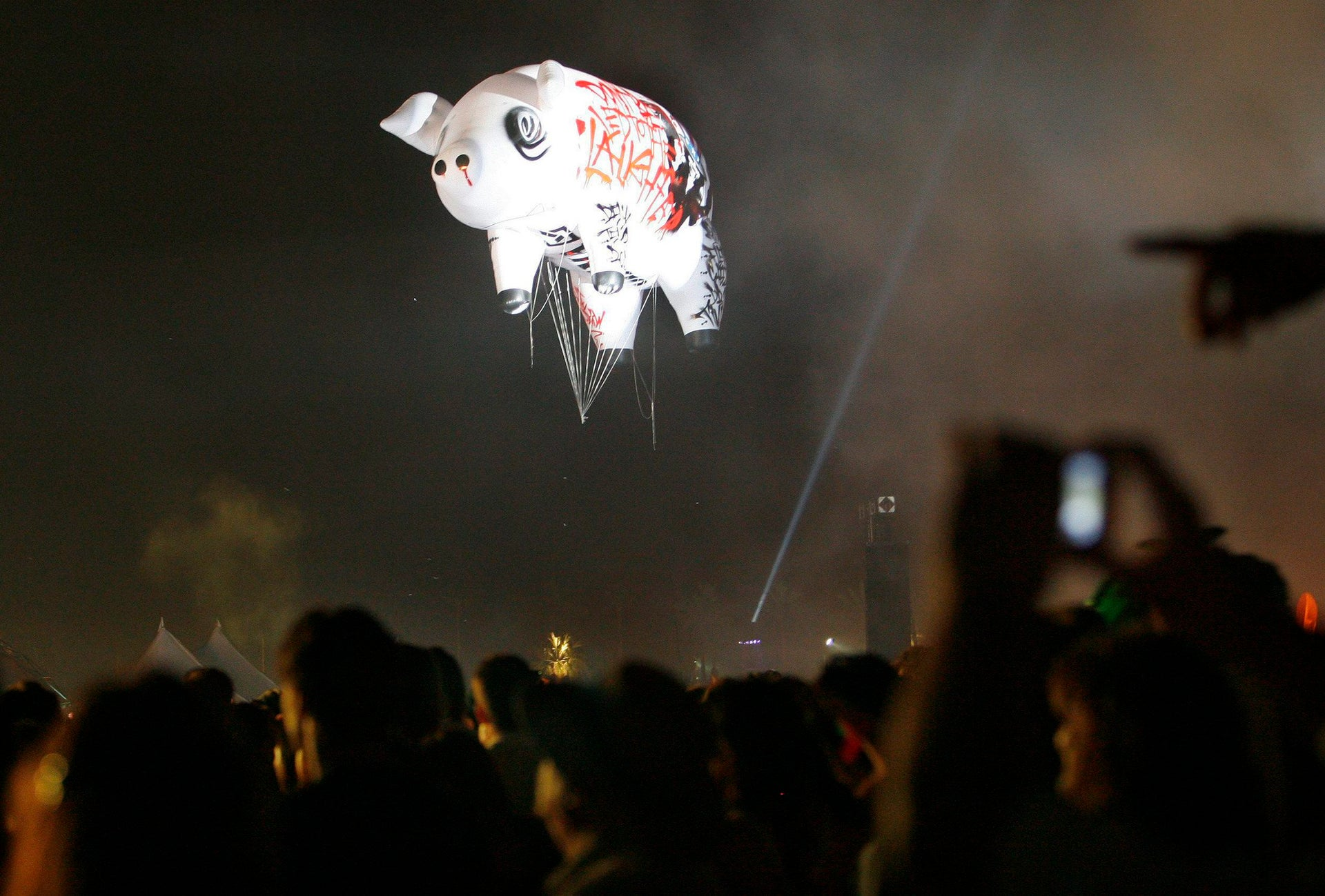 A pig-shaped balloon is seen in the sky as Roger Waters performs at the Coachella Music Festival in Indio, California April 27, 2008.