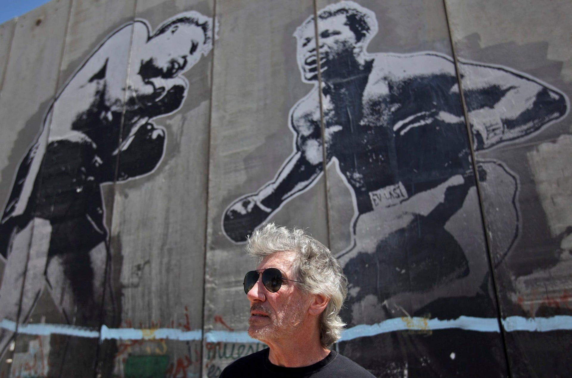 Composer and former bassist and singer of British rock band Pink Floyd, Roger Waters, is seen while touring Israel's separation barrier in the West Bank refugee camp of Aida in Bethlehem, Tuesday, June 2, 2009. In an interview with The Associated Press, Waters denounced the wall as a land grab by Israel, said it must come down and promised to hold a concert on that spot if it does.