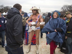 New York City's Naked Cowboy joins protesters and supporters on the National Mall for the inauguration of Donald Trump on January 20, 2017 in Washington, D.C.