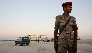 File photo: An Egyptian soldier stands guard at a military base north of Suez, Egypt.