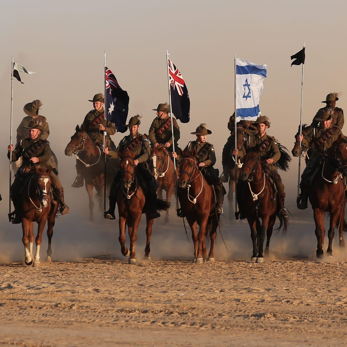 Australian Mounted Division and New Zealand Mounted Division soldiers ride their horses during the reenactment of the Battle of Be'er Sheva in southern Israel, Tuesday, Oct. 31, 2017.
