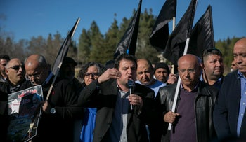 Joint List chairman Ayman Odeh speaks in front of the Knesset at a demonstration against home demolitions in Arab communities, January 23, 2017.