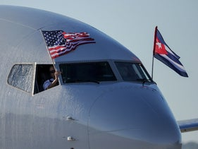 An American Airlines plane with U.S. and Cuban flags arrives in Havana's Marti International Airport, November 28, 2016.