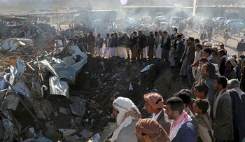 People gather at the site of an air strike in the northwestern city of Saada, Yemen November 1, 2017.