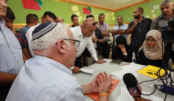 Agriculture and Rural Development Minister Uri Ariel meeting Bedouin parents at a high school in Hura, January 2015.