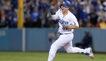 Los Angeles Dodgers outfielder Joc Pederson celebrates after hitting a solo home run against the Houston Astros in the 7th inning in game six of the 2017 World Series, October 31, 2017.