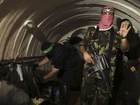 A Palestinian fighter from the Izz al-Din al-Qassam Brigades, the armed wing of the Hamas movement,  inside an underground tunnel in the Gaza Strip, August 18, 2014.